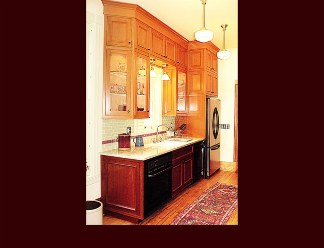 Cherry kitchen cabinetry flat panel door style with applied moulding