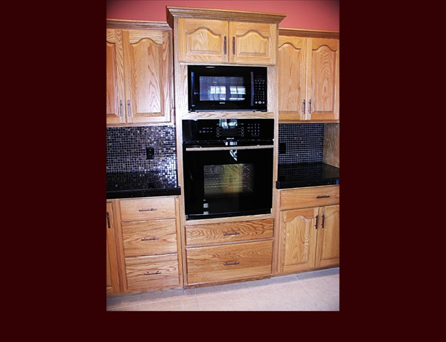 Custom Oak Kitchen Remodel Raised Panel Cathedral Door Style Full Height Wall Oven Cabinet